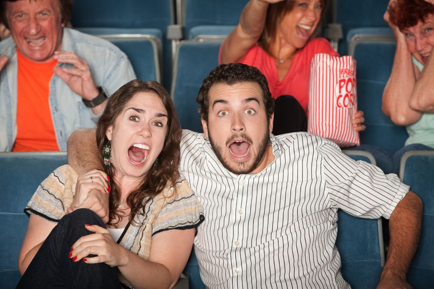 12640855 - group of people in audience react in fear